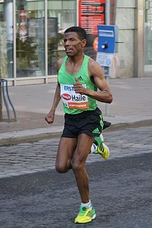 Haile Gebrselassie  born 18 April, 1973 is an Ethiopian long-distance track and road running athlete. He won two Olympic gold medals over 10,000 metres and four World Championship titles in the event. He won the Berlin Marathon four times consecutively and also had three straight wins at the Dubai Marathon. Further to this, he won four world titles indoors and was the 2001 World Half Marathon Champion.