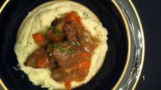 This recipe comes from Rach's mom, Elsa Scuderi. Apple cider is the key to this hearty beef, served over smashed potatoes. Ingredients 2 tablespoons extra virgin olive oil (EVOO) 3 tablespoons butter 2 pounds top sirloin, trimmed and cut into 2-inch cubes Salt and freshly ground black pepper 1 large onion, chopped 2 medium carrots, …