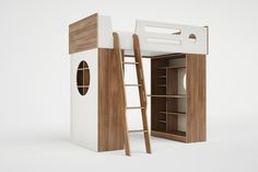 Our Dumbo Loft Bed features two reversible cabinets below the bed, as well as an adjustable desk and open shelving/storage unit. The desk and bookshelves are designed to face either in or out to adapt to virtually any space. The attached ladder features cut-out handrails for increased safety