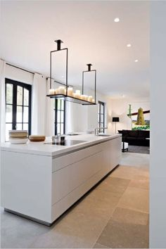 Soft contrast: Grey tile with white cabinetry