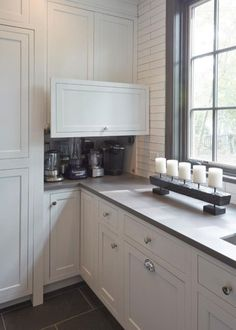 Example of a huge country porcelain floor and brown floor kitchen pantry design in Chicago with a double-bowl sink, recessed-panel cabinets, white cabinets, marble countertops, white backsplash, ceramic backsplash, stainless steel appliances and an island #kitchen #farmhouse