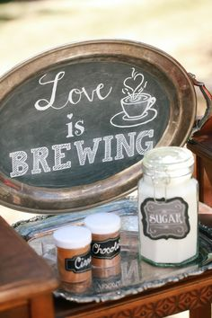 "Fall bridal shower - tea coffee bar with chalkboard ""Love is Brewing"" sign {Courtesy of American Vintage Rentals}"