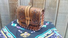 Check out this item in my Etsy shop https://www.etsy.com/ca/listing/475636563/small-leather-tooled-purse-to-attach-to