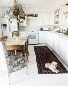 Atlantis Home interiors, Follow @Judy Aldridge | Atlantis Home on Instagram, or check out the blog at www.atlantishome.com . . #kitchen #homeinteriors #homedecor #decor #curtains #dog #puppy #poodle #rug #antiquerug #farmtable #table  #white #interiors #inpso #kitcheninspo #blog