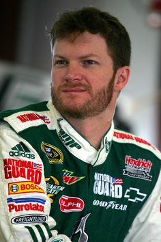 Dale Earnhardt Jr., driver of the #88 AMP Energy/National Guard/Mountain Dew Chevrolet, stands in the garage during practice for the NASCAR Sprint Cup Series Toyota/Save Mart 350 at the Infineon Raceway on June 19, 2009 in Sonoma, California.