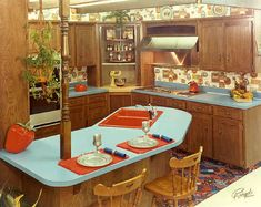 This feels so much like my 1970's childhood kitchen; the busy-print carpeting, the wallpaper, that giant strawberry cookie-jar (my mom had the pear). Love it. Want!