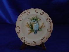 Piatti decorativi con figure di uccelli in Porcellana di Capodimonte.