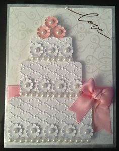 Wedding card by Ivory.... love the embossing and pearls on the cake.