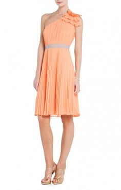 A vibrant hue, posh sunburst pleats, and a classic fit make this the perfect bridal party dress. Asymmetrical neckline. Single strap at left shoulder. A-line skirt. Micro-pleating throughout. Contrast banded waist. $180.00 Embellishment at shoulder. Concealed center back zipper with hook-and-eye closure. Chiffon: Polyester. Dry Clean. Imported