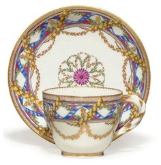 A SEVRES PORCELAIN CUP AND SAUCER (GOBELET 'HERBERT' ET SOUCOUPE, 2EME GRANDEUR) CIRCA 1765, BLUE INTERLACED L'S MARKS AND PAINTER'S MARK FOR LE GUAY, INCSED -PR TO THE CUP AND L10 TO THE SAUCER