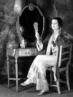 June Collyer perfects her hair - c. 1920s