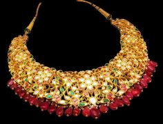 Magical Jadau necklace in gold & rubies