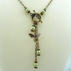 Jewelry OFF! Handmade Green Pearl Bee Lariat Necklace with Antique Brass Chain and Toggle Clasp Jewelry Clasps, Boho Jewelry, Pendant Jewelry, Beaded Jewelry, Vintage Jewelry, Handmade Jewelry, Jewelry Design, Unique Jewelry, Pearl Pendant