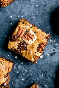 Beautiful grain free pecan blondies made with a homemade DIY pecan butter. The MOST addicting fudgy blondies out there. Paleo & dairy free.