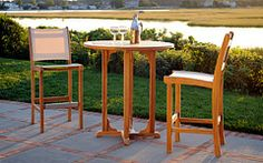 Add the Kingsley Bate Essex Round Bar Table to your balcony, patio or by the pool and get your next party started. The warm teak wood constr Bar Table And Stools, Round Bar Table, Outdoor Bar Stools, Outdoor Tables And Chairs, Patio Bar, Patio Chairs, Bar Chairs, Bar Tables, High Chairs