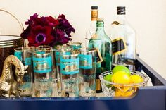 Having a swanky dinner party with some fabulous friends? Display beautiful glasses and other bar essentials out in the open on a large tray. A tray can serve as a temporary bar for those who don't want liquor out all the time.