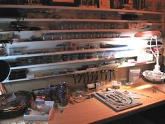 Look at her clever storage and right at hand too! Jewelry work bench of Catherine Gray