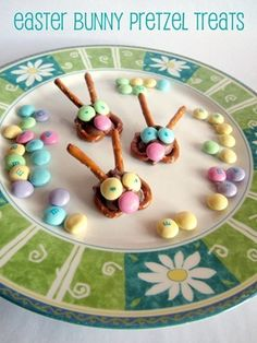 You're melting a kiss on a pretzel, adding straight pretzel ears, and then pastel m's that you draw on after the fact.  Easy and child-friendly.