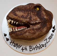 Dinosaur head... chocolate cake with chocolate ganache and fondant. This would be perfect for my cousin doug
