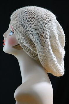 Free Knitting Pattern for Super Slouch Hat - knit flat on straight needles with lace bands. Can be customized to be less slouchy. This and more free slouchy hat knitting patterns at http://intheloopknitting.com/slouchy-hat-knitting-patterns/