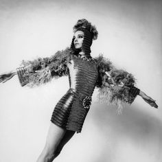 1960s Paris Fashion  An original ensemble created by Paco RABANNE for his spring/summer 1969 collection, a coat-of-mail dress composed of metal sequins and ostrich feathers on the arms. The hair style uses the same materials. Photo by Keystone-France