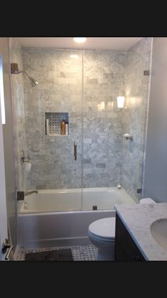 How You Can Make The Tub Shower Combo Work For Your Bathroom Grey Subway Tiles Tub Shower Combo And Glasses