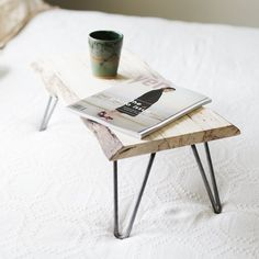 A piece of wood from a lumberyard paired with some hairpin legs makes the perfect lap desk for reading or working on the computer in bed!