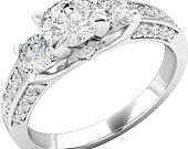 Round brilliant cut three stone diamond ring 18ct white gold