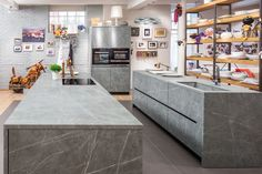 How to Choose the Right Material For Every Surface of Your Home - Photo 12 of 13 - Fusion Zaha Stone kitchen Key Kitchen, Stone Kitchen, Farmhouse Style Curtains, Farmhouse Style Kitchen, Kitchen Images, Kitchen Photos, Brown Bar Stools, Wood Sink, Open Cabinets