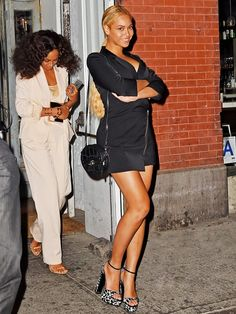 81f6693b32a6d Beyoncé wears a black mini dress with zipper detailing, Tom Ford platform  sandals, and