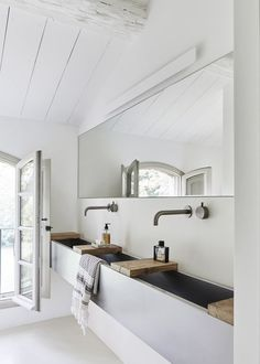 Bathroom with wooden shelves over the large sink: