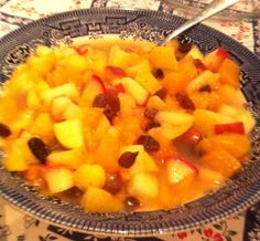 Fruit salad of apples stewed with icing sugar, diced peaches in syrup and sultanas!