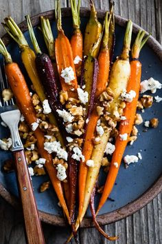 These maple roasted carrots are tossed in smoked paprika and maple syrup before roasting then sprinkled with walnuts and feta for serving. Use small rainbow carrots or even medium to large orange carrots to whip up this easy side dish!