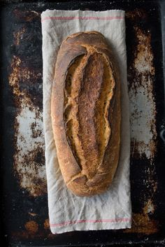 TRUCCIONE SARÉ Our house specialty. Rustic country bread. Sourdough oval loaf with dark crust, 40% whole wheat flour, irregular crumb structure. Excellent for table bread, long shelf-life. Available in two sizes.