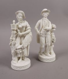 A PAIR OF MINTON PARIAN FIGURES of a gardener and companion, in the white, on circular moulded ba