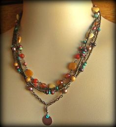 "Multistrand Necklace by yucca bloom. Carnelian, red jasper, turquoise, goldstone, seed beads. 18""."