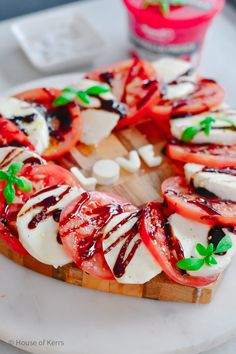 Grab a heart-shaped food board & some mini food cutters and try this simple spin on a classic Caprese Salad | Date night recipes | appetizers | antipasto | appertivo | Italian food