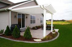 White composite pergola and paved patio. The Vande Hey Company, Inc.