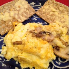 300 calorie breakfast.  Sauté 1/2 cup sliced mushrooms and 1 tsp shallots in organic olive oil pam until mushrooms begin to shrink. Remove from heat. Add more Pam and scramble 1 egg, 1 egg white (& approx 1/8 cup organic skim milk.) After1 minute or so on medium low heat, add 1/4 or less cup of shredded 2% cheddar cheese and shallot/mushroom mixture. Continue cooking until eggs are done. Serve with 2 pieces of wasa fiber crispbread topped with 1.5tsp organic smart balance buttery spread.