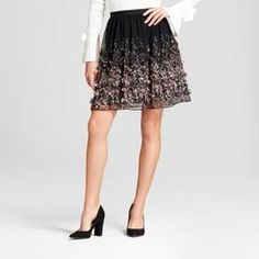 Elevate your collection of ladylike skirts by adding the Floral Textured Skirt from A New Day™ to your closet. This skirt features a flattering A-line silhouette that lets you create a variety of looks to fit your own unique style. A textured floral design brings some definition to the skirt, while letting you keep the rest of your pieces simple and to a minimum. Pair with a fitted shirt with bell sleeves and slip into a pair of block-heel shoes for an edgy-meets-sweet style, or opt ...