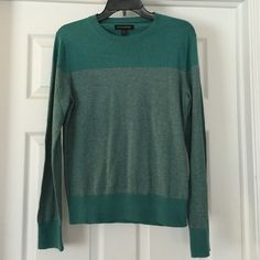 Banana Republic sweater Gorgeous! Like new Pima cotton and cashmere Banana Republic sweater. Green with tiny pin striping across front. Size on tag says XS. I wear a L and this is how it fits me!! Lightweight and perfect for spring. Banana Republic Sweaters Crew & Scoop Necks