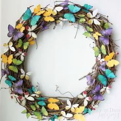 Add a pop of color to your door with a Spring wreath made with paper butterflies in three easy steps! Perfect for eclectic Spring decor.
