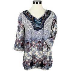 The Chloe Top is hand made from 100% of the softest cotton for your enjoyment in all kinds of weather. It features a lovely colourful batiked pattern with embro