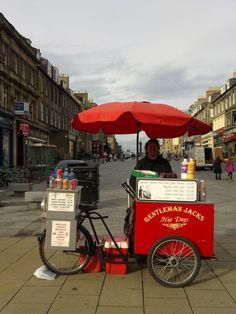 'Castle Street hotdog' - Jennifer Mckay Mobile Cafe, Akron Zips, Scottish Gin, Hot Dog Cart, Hot Dog Stand, Scottish Recipes, Parasols, Food Carts, City Scene