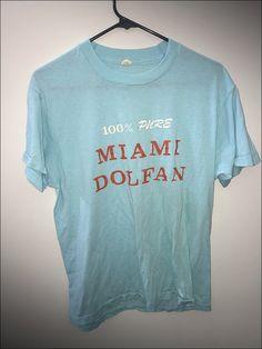 fe1691311 Vintage 80 s NFL Miami Dolphins 100% Dolfan Shirt - Size Medium by  RackRaidersVtg on Etsy