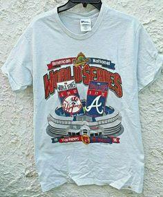 Vintage 1996 Yankees vs Braves World Series Shirt Medium Pro Player Tag Gray by Fchoicevintage on Etsy shirts Vintage Rock Tees, Vintage Shirts, Vintage Men, Etsy Vintage, Atlanta Braves World Series, Katie Roberts, World Series Shirts, Subway Series, College Shirts