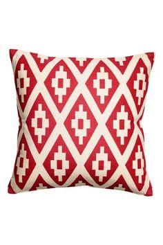 Wzorzysta poszewka na poduszkę: Poszewka na poduszkę z bawełnianego płótna. Przód we wzorzyste nadruki, jednolity tył. Kryty suwak.