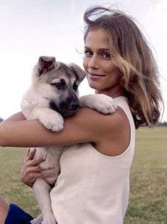 Lauren Hutton, 1974 .. and a cute dog friend