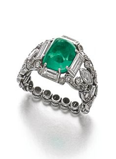 EMERALD AND DIAMOND RING, 1930S centring on a sugarloaf cabochon emerald, the articulated band set with marquise-shaped, circular-, single-cut and baguette diamonds