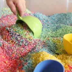 How to create a brightly colored rainbow rice box kids will play with for hours and hours on end.